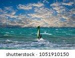 one surfer or windsurfer... | Shutterstock . vector #1051910150