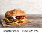 tasty burger with bacon on...   Shutterstock . vector #1051924493