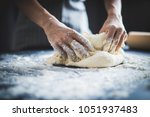 making dough by female hands at ... | Shutterstock . vector #1051937483