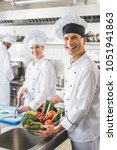smiling chefs looking at camera ...   Shutterstock . vector #1051941863