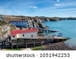 boat houses at st justinian... | Shutterstock . vector #1051942253