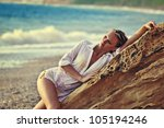 the sexy woman on a beach in... | Shutterstock . vector #105194246