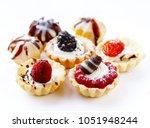mini dessert tarts sweet... | Shutterstock . vector #1051948244