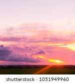 fiery cloud setting sun  | Shutterstock . vector #1051949960