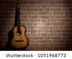 guitar and wall  brick light... | Shutterstock . vector #1051968773