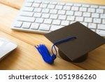 graducate cap on keyboard with...   Shutterstock . vector #1051986260