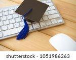 graducate cap on keyboard with...   Shutterstock . vector #1051986263