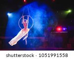 Aerial acrobat in the ring. a...