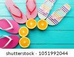 summer fun time and flip flops. ...   Shutterstock . vector #1051992044
