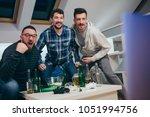 group of friends watching sport ... | Shutterstock . vector #1051994756