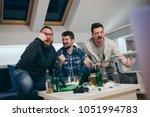 group of friends watching sport ... | Shutterstock . vector #1051994783