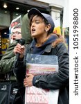 London, United Kingdom, 17th March 2018:- A speaker at the Stand Up to Racism march through central London - stock photo