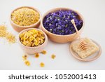 bowls full of different herbs... | Shutterstock . vector #1052001413