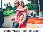 positive couple in love... | Shutterstock . vector #1052019800