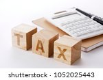 tax calculation image | Shutterstock . vector #1052025443