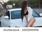 the sensual brunette woman in... | Shutterstock . vector #1052044496