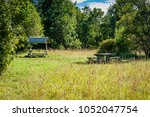 picnic place in forest. estonia. | Shutterstock . vector #1052047754