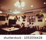 blur resturant and coffee shop... | Shutterstock . vector #1052056628
