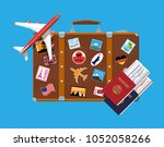 travel suitcase with stickers... | Shutterstock .eps vector #1052058266