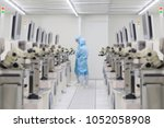 blurred image of technician in... | Shutterstock . vector #1052058908
