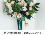 rich green wedding bouuqet on... | Shutterstock . vector #1052061446