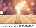 empty wooden board or table and ... | Shutterstock . vector #1052070980