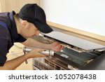 craftsman or electrician checks ... | Shutterstock . vector #1052078438