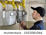 Heating Fitter Checks Gas...