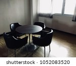 wooden table in modern working... | Shutterstock . vector #1052083520