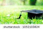 graduation cap in graden  ... | Shutterstock . vector #1052103824