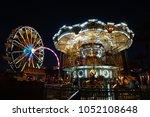 mini amusement park at night. | Shutterstock . vector #1052108648
