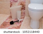 white counting bucket toilet... | Shutterstock . vector #1052118440