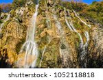 lower view of waterfalls in... | Shutterstock . vector #1052118818