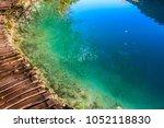 amazing view of wooden pathway... | Shutterstock . vector #1052118830