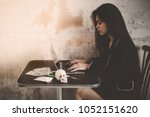 beautiful woman is typing some... | Shutterstock . vector #1052151620
