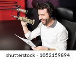 smiling young male radio...   Shutterstock . vector #1052159894