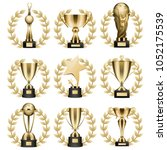trophy cups and statuettes... | Shutterstock .eps vector #1052175539