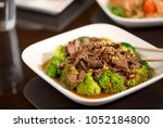 thai stir fry beef entree with... | Shutterstock . vector #1052184800