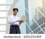 young burmese businessman find...   Shutterstock . vector #1052191409
