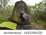 female climber with boulder... | Shutterstock . vector #1052200220