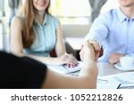 business meeting in a cafe... | Shutterstock . vector #1052212826