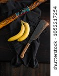 Small photo of bananas and machete on a table