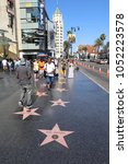 Small photo of Los Angeles, USA – July 10, 2017: People on Hollywood Walk of Fame in Hollywood, California. In front the Star of Bob Thomas