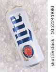 Small photo of IRVINE, CALIFORNIA - MARCH 21, 2018: A 24 ounce king can of Miller Lite on ice. Introduced in 1975 Miller Lite was the first mainstream light beer.