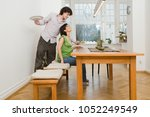 man serving his partner a meal | Shutterstock . vector #1052249549