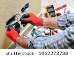 electrician technician at work... | Shutterstock . vector #1052273738