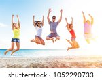 group people on beach | Shutterstock . vector #1052290733
