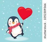 penguin holding heart sign.... | Shutterstock .eps vector #1052309366