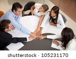 Group of business people at the office with hands together in the middle - teamwork concepts - stock photo