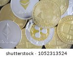 large stack of cryptocurrencies ...   Shutterstock . vector #1052313524